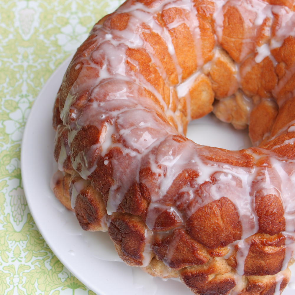 monkey bread on a plate with icing glaze