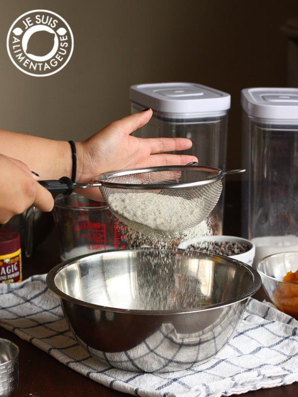 Sifting flour for Pumpkin Chocolate Chip Muffins | alimentageuse.com #pumpkin #fall #chocolate #vegan
