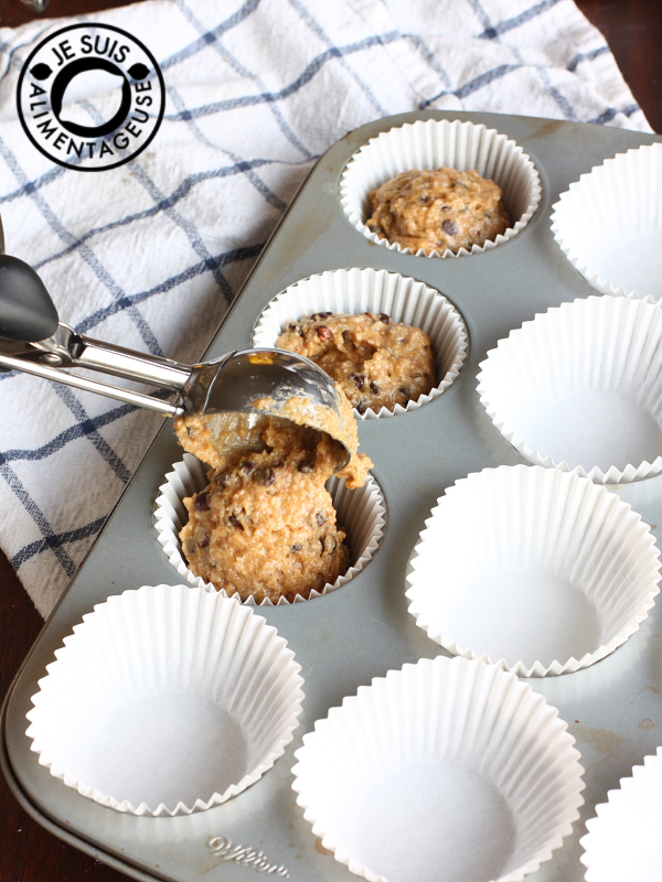 Scooping the batter into the muffin tins | Pumpkin Chocolate Chip Muffins | alimentageuse.com #pumpkin #fall #chocolate #vegan