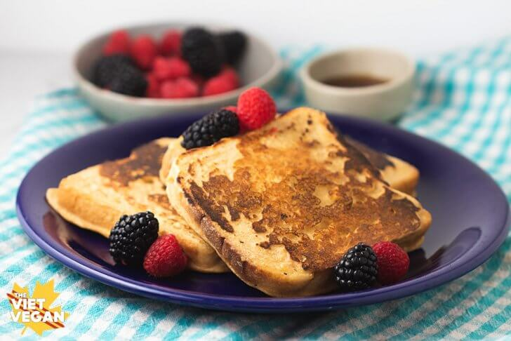 vegan french toast on a plate with berries