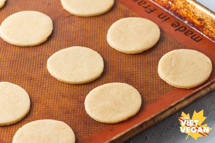 Cut cookies on baking sheet