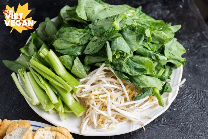 mung bean sprouts, yu choy and pea shoots, on a plate