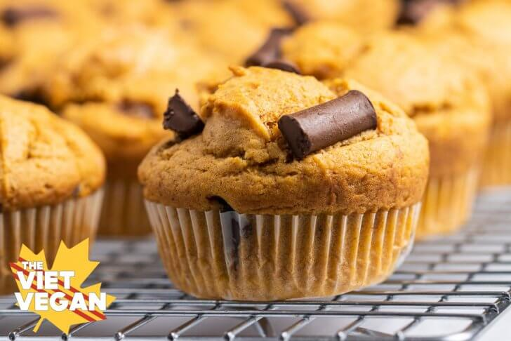 chocolate chunk muffins on a cooling rack, close up