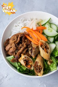 vermicelli bowl with spring rolls, noodles, pickled carrots and daikon, cucumber and lettuce