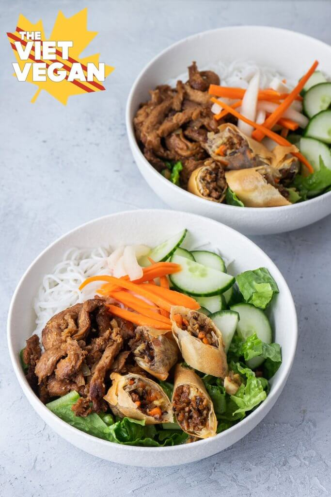 twp vermicelli bowls with spring rolls, noodles, pickled carrots and daikon, cucumber and lettuce