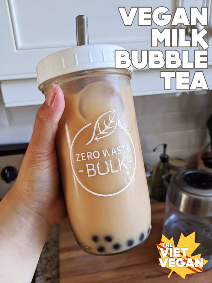 bubble tea in a tall 16oz jar with a white lid and metal straw