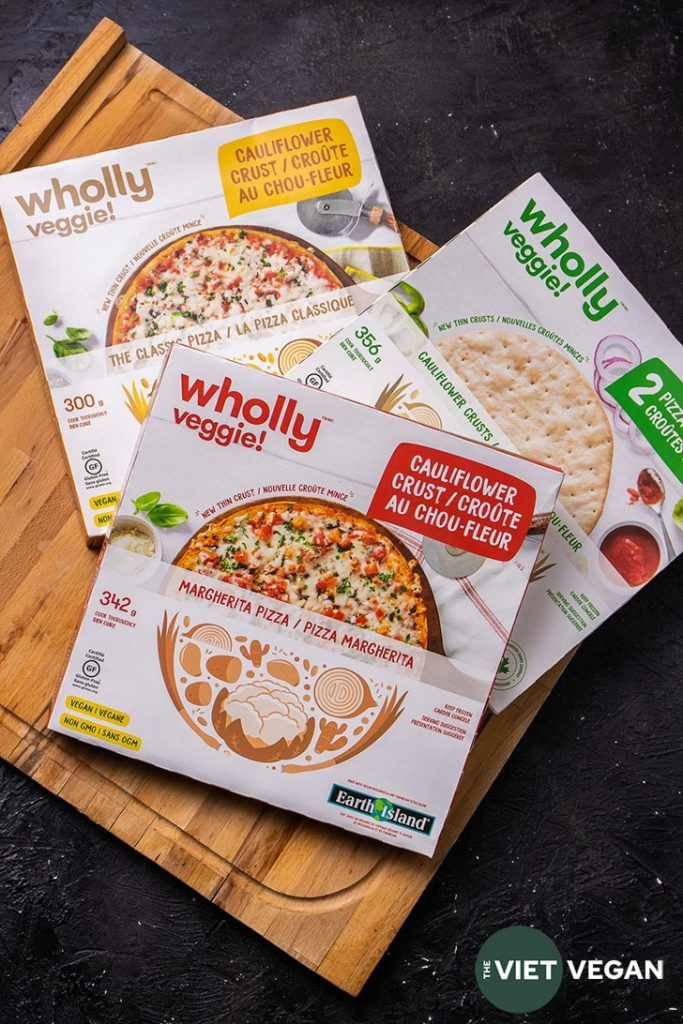 Three boxes of Wholly Veggie Pizza, in classic cheeze flavour, margherita flavour, and two naked cauliflower crusts