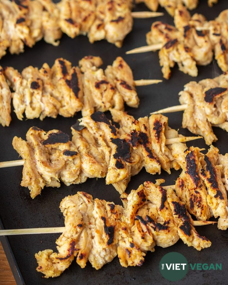 skewered marinated soy curl satay on the griddle, caramelized
