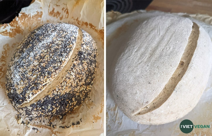 Two different sourdough loaves (one seed crusted, the other is plain), scored, before baking.