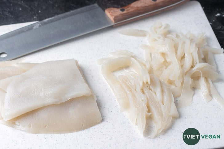 Steamed noodles being chopped