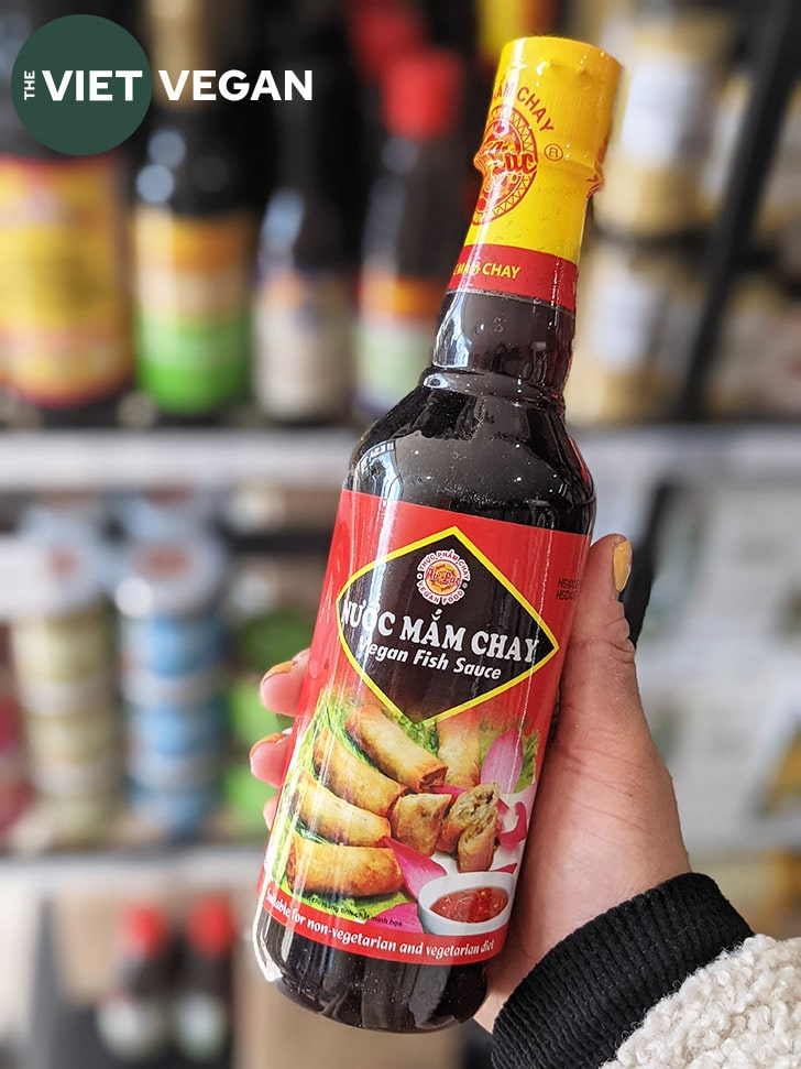 vegan fish sauce bottle with other bottles of seasonings in the background