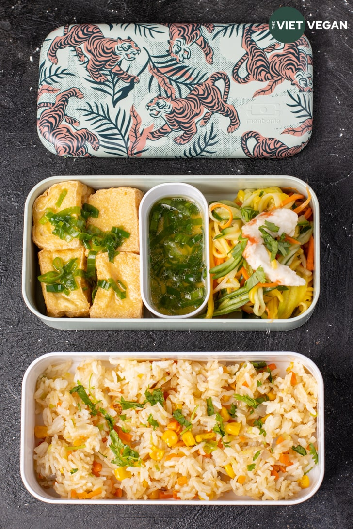Fried tofu with green onion sauce, green mango salad, and fried rice