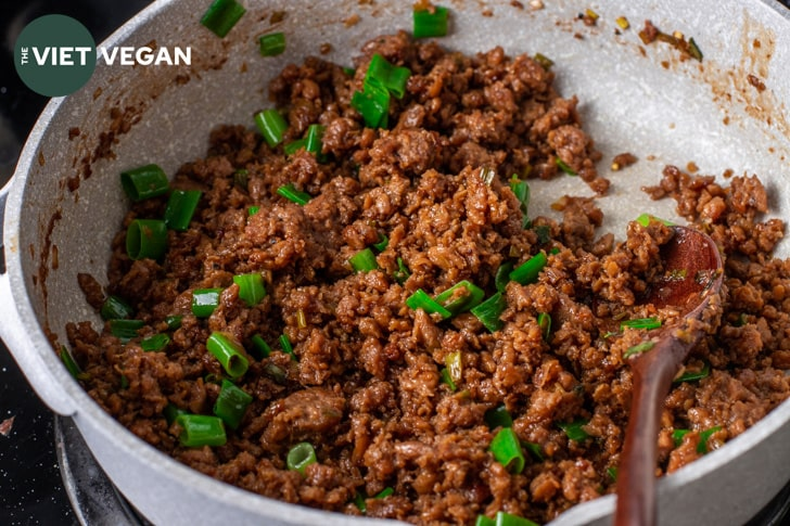Bulgogi ground cooked with the greens from a green onion just added in