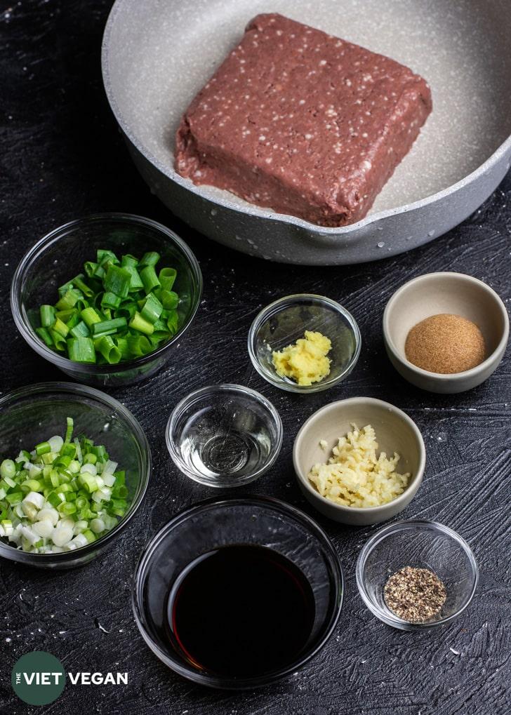 vegan bulgogi ingredients in separate bowls on a dark surface