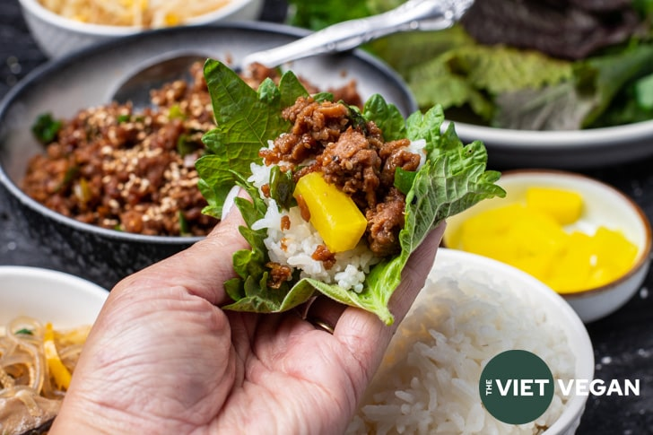 vegan bulgogi with rice, and pickled radish in a shiso leaf