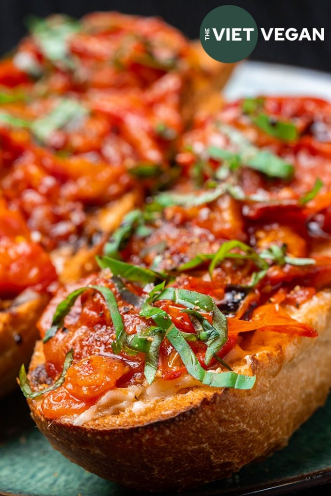 close up of tomato garlic confit toast