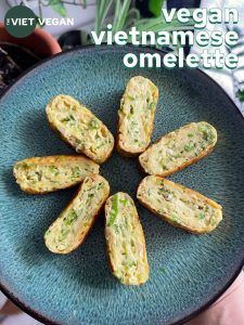 Seven pieces of Vietnamese vegan omelette in a star on a green plate
